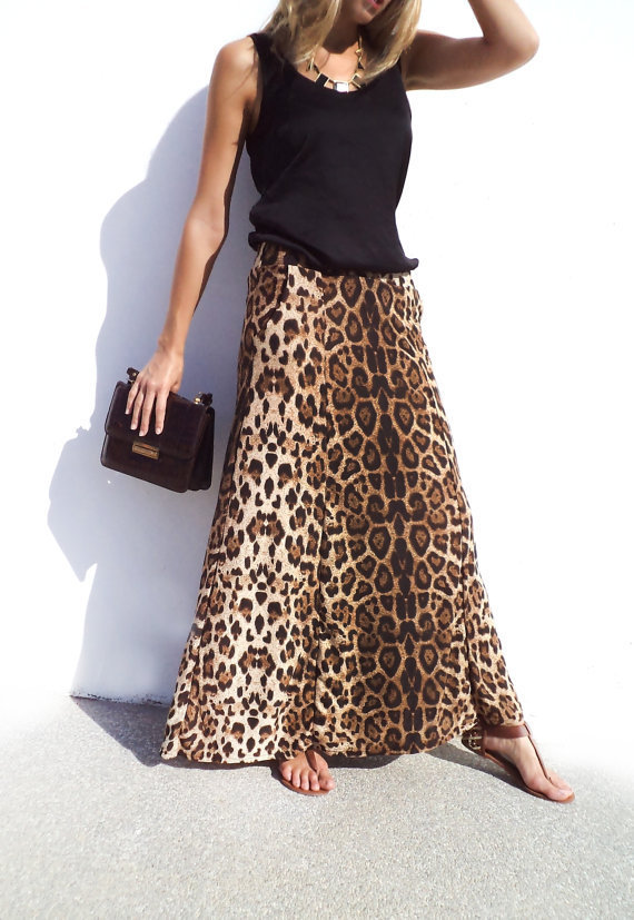 Leopard maxi skirt, black length shirt, black belt, black shoes, perf for fall. Find this Pin and more on fash by Prec Jess. beautiful leopard maxi skirt belted with a long sleeve top.