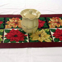 Christmas table runner with pointsettas in golds, reds and burgandy