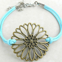 Bracelet - antique bronze flower bracelet, together with the blue wax line