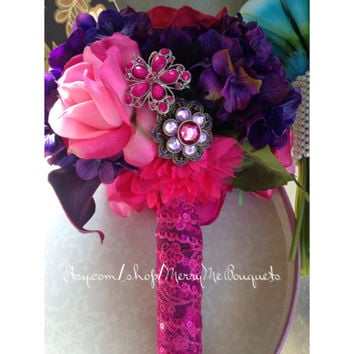Vibrant purple and fuchsia pink wedding bouquet. All true touch flowers. Very realistic.