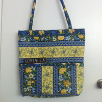 Beautiful quilted blue and yellow flowered diaper or book bag