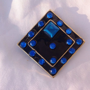 1980s felt back pin. Bright blue on black.