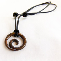 Constant Motion Pendant in antique bronze