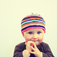Knitted striped hat baby girl
