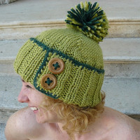 Woman's knit hat in green with pom pom