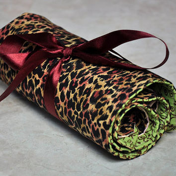 travel cosmetic, and toiletry roll -- leopard print, pink, and green leaf patterned, makeup, jewelry, art supplies