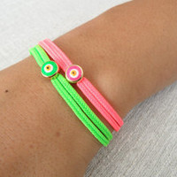 2 neon evil eye friendship bracelets in green and pink, neon bracelets, evil eye
