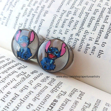 Pair of hand drawn Lilo and Stitch plugs sizes 10mm and above.