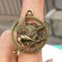 SALE--The Hunger Games pendant ,Inspired Mockingjay ring-Bronze
