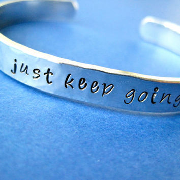 Hand stamped Bracelet - just keep going - motivational bracelet - Hammered aluminum metal finish - Skinny 1/4 inch
