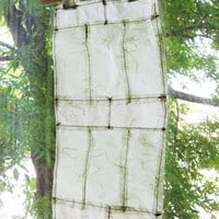 Paper window quilt. Mulberry paper scraps sewn together. Light green window decor. Illuminating