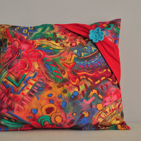Colorful  pillow  case with crocheted flower
