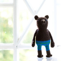 Crocheted soft toy, amigurumi - Bruno the brown bear with striped pants in green and blue.