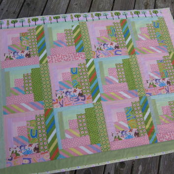 Girl quilt pink and green curving log cabin style girl blanket ABC Menagerie