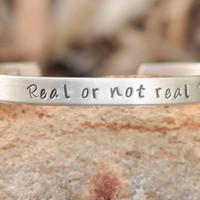 Hunger Games - hand stamped cuff bracelet - Real or not real
