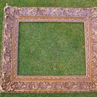Antique gold frame large with heavy gilt plaster decor by clcort