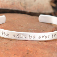 Hand stamped Hunger Games cuff bracelet, May the odds be ever in your favor
