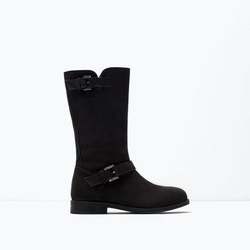 Lined leather boot with buckle