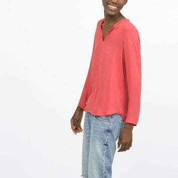 Shirt with piped neckline