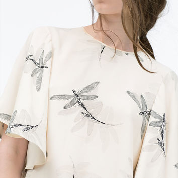 Printed top with cape sleeves