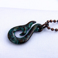 Whale Tail Hook in ocean floor with copper ball chain