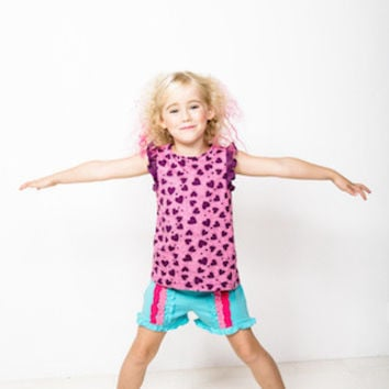Girls cotton jersey fun shorts in turquoise with three colour vertical frill detail.