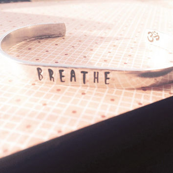 BREATHE bracelet  om symbol inside