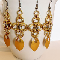 Gold and Silver japanese cross earrings with matching gold scales jewelry