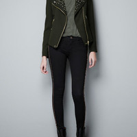 JACKET WITH ZIPS AND STUDDED LAPEL