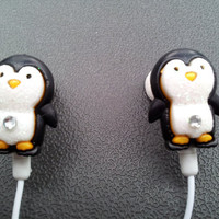 Adorable  pair of Penguin earbuds with glitter and a swarovski crystal