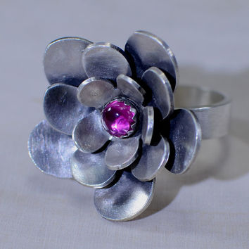 Sterling silver cocktail ring with three layered flower and pink ruby