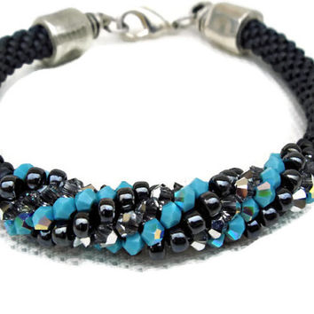 Bead crochet spiral bracelet with Swarovski elements. Turquoise. Charcoal. Bright Crystal.