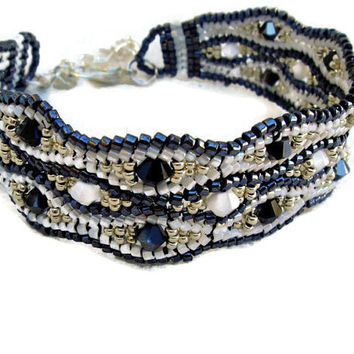 White, black and silver beaded bracelet with Swarovski elements. Seed beads jewelry