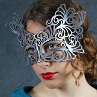 Rococo  leather mask in silver