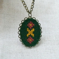 Ukrainian ornament on dark green felt  hand embroidered by skrynka