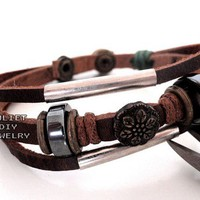 Brass button inlaid leather bracelet with hemp rope wrapped
