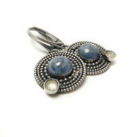 Silver metalwork earrings , blue kyanite stone , circle
