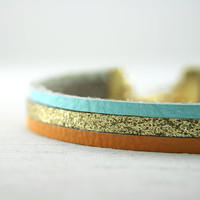 leather bracelet in orange, aqua, and glittery gold