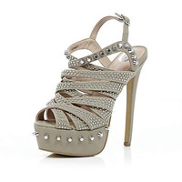 Beige stud caged sandals