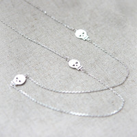 Silver Long Necklace with three skulls