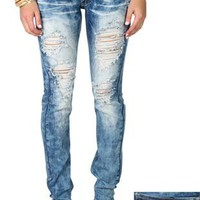 machine skinny jean featuring crinkles and heavy destruction - debshops.com