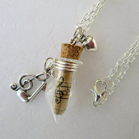 Musical  scroll with clef, note and tiny heart silver toned charms glass vial necklace