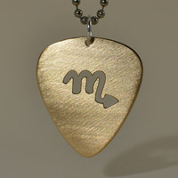 Bronze guitar pick pendant with custom zodiac cut out