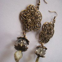 Antique brass flower dangle earrings by cataclysmos on Etsy