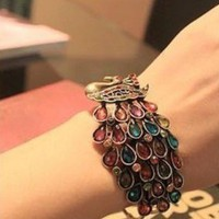 Royal Peacock Bangle by DaliaLabasi on Sense of Fashion