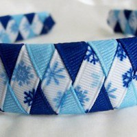 Woven headband with blue and light blue grosgrain ribbon snowflakes