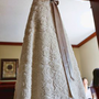 Lace wedding dress with purple sash