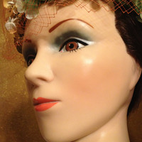 Vintage Mannequin Head with an Intricate Flowered Hat on. Definitely a Pretty Lady from Days Gone By