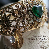 Vintage Bangle Bracelet, Gold tone wide bracelet with Emerald Green Heart, Vintage Prayer Medal, and Charms by Secrets and Stories