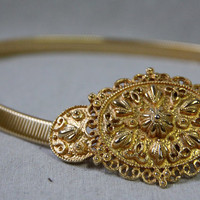 VTG skinny gold stretchy belt
